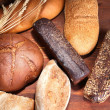Much bread on wooden board — Stock Photo #30313847