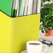 Stock Photo: Magazines and folders in green box,on office interior background