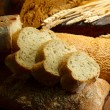 Much bread on wooden board — Stock Photo #30314017