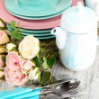 Lots beautiful dishes on wooden table close-up — Stock Photo #30314055