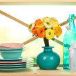 Beautiful dishes on wooden cabinet on natural background — Stock Photo #30314057