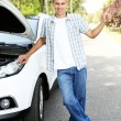 Man on road with car breakdown trying to stop car — Stock Photo #30314165