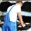 Professional car mechanic working in auto repair service — Stock Photo #30314239