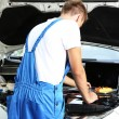 Professional car mechanic working in auto repair service — Stock Photo