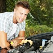 Young driver repairing car engine outdoors — Stock Photo #30314255