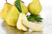 Pears on metal background — Stock Photo