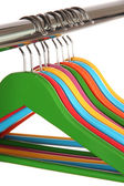 Colorful clothes hangers isolated on white — Stock fotografie