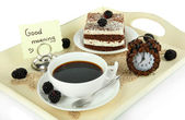 Cup of tea with cakes on wooden tray isolated on white — Stock Photo