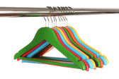 Colorful clothes hangers isolated on white — Foto de Stock