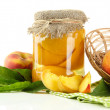 Постер, плакат: Jar of canned peaches and fresh peaches isolated on white