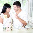 Stock Photo: Beautiful young romantic couple at cafe