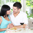 Stock Photo: Beautiful young couple at restaurant