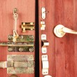 Metal bolts, latches and hooks in wooden open door close-up — Lizenzfreies Foto