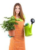 Beautiful girl gardener with flower isolated on white — Stock Photo