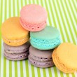 Stock Photo: Gentle macaroons on green background