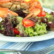 Stock Photo: Boiled crab on white plate with salad leaves and tomatoes,on wooden table background