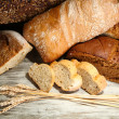 Much bread on wooden board — Stock Photo #30404191