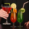 Stock Photo: Bartender with different cocktails, close-up