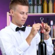 Bartender opens bottle of wine — Stock Photo #30405157