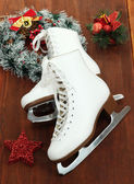 Figure skates on table close-up — Stok fotoğraf