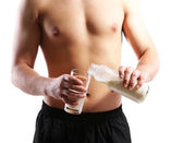 Handsome young muscular sportsman with protein drink, isolated on white — Stock Photo