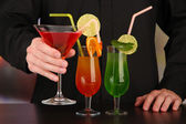 Bartender with different cocktails, close-up — Stock Photo