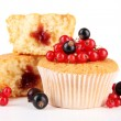 Tasty muffins with berries isolated on white — Stock Photo #30411923