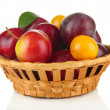Ripe plums in basket isolated on white — Stock Photo #30412095