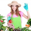 Beautiful girl gardener with flowers isolated on white — Stock Photo