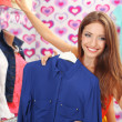 Beautiful young woman in shop — Stock Photo