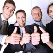 Stock Photo: Business team showing thumbs up in office