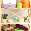 Beautiful white shelves with different home related objects, on color wall background — Stock Photo #30416959