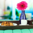 Stock Photo: Wooden tray with breakfast, on bright background