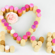 Stock Photo: Wine corks laid out in form of heart isolated on white