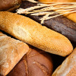 Much bread on wooden board — Stock Photo #30417869