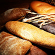 Much bread on wooden board — Stock Photo #30417871