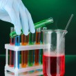 Laboratory glassware on dark color background — Foto Stock