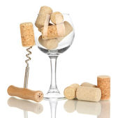 Wineglass and corks isolated on white — Stock Photo