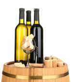Wine and corks on barrel isolated on white — Stock Photo