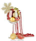 Wine glass filled with christmas decorations, isolated on white — Stock Photo