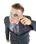 透过放大镜在白色孤立的年轻商人 — 图库照片