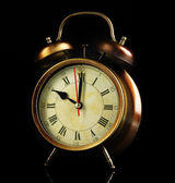Old alarm clock isolated on black — Stock Photo