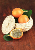 Passion fruits in wicker basket on table close-up — Stock Photo