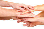 United hands isolated on white Conceptual photo of teamwork — Stock Photo
