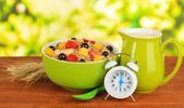 Oatmeal with fruits on table on bright background — Stock Photo