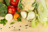 Fresh vegetables in basket on wooden table close-up — Stock Photo