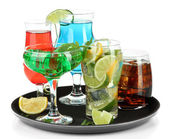Many glasses of cocktails on tray, isolated on white — Stock Photo