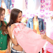Three beautiful young woman in shop  — Stock Photo