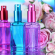 Women perfume in beautiful bottles and flowers — Stock Photo #30468391