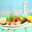 Stock Photo: Boiled crab claws on white plate with salad leaves and tomatoes,on wooden table, on bright background